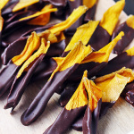Yummy chocolate covered mango strips are a great dessert or snack. Gluten-free, dairy-free and vegan. | tiaskitchen.com/chocolate-covered-mango-strips-recipe-gluten-free-dairy-free-vegan